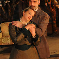 Actors embrace in the Cherry Orchard.