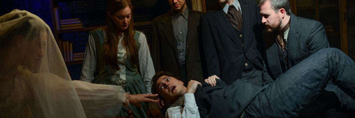 A chorus of five narrators surrounds Mike Tepeli as Pip in a scene from Great Expectations.